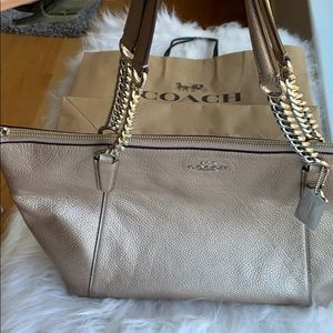 Gently used Coach rose gold/platinum leather purse